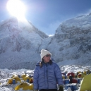 team-doctor-monica-with-everests-west-shoulder-and-the-icefall-behind.jpg
