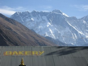 Everest's summit ridge pokes above the Nuptse ridge - our first view