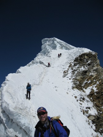 Looking back at the summit cornice on the descent