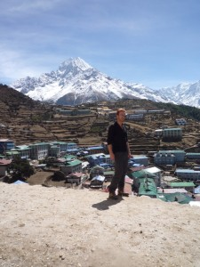 Me in front of the Alpine Lodge with Namche Bazar in the background