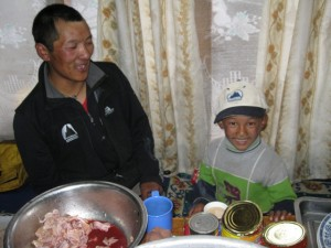 Everest legend Phurba Tashi and his son in the lodge kitchen