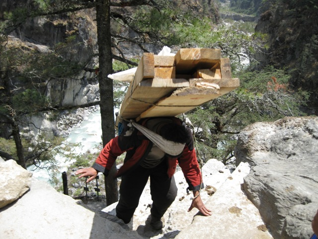 A porter descending with wood for building