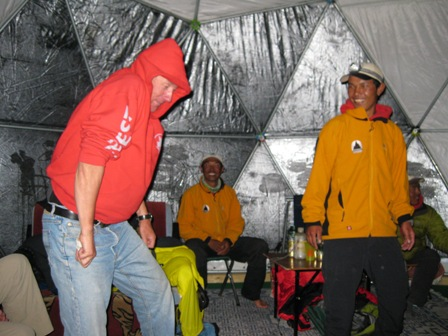 Russell 'doing' Eminem, as a sherpa looks on