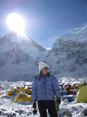 Day 2 sunshine!  Team doctor Monica Piris with Everest's west shoulder (the summit is hidden) and the infamous Icefall behind