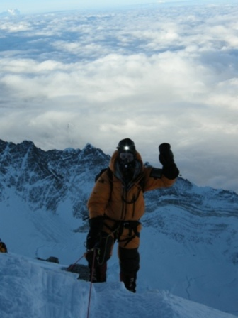 Me reaching the South Summit, arm aloft, at 8,750 meters - 5.30am, 21 May