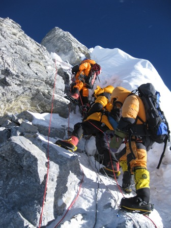 Team-mate Moises Nava Falcon and two Sherpas tackle the Hillary Step - 06.30am, 21 May
