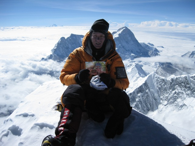 On the summit holding a picture of Alix and me - again note the clearly visible curvature of the earth on the horizon behind me - 21 May