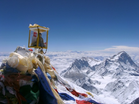 Prayer flags and a figure of Buddha on the summit of Everest - 21 May