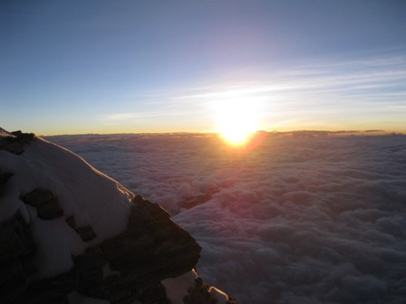 Sunrise breaks just below the South Summit - 21 May